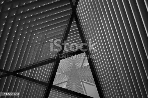 istock Reworked photo of sloped walls. Realistic though unreal industrial interior. 626588170