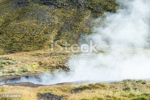 Reykjadalur, Iceland Hveragerdi Hot Springs abstract closeup of steam fumarole vent vapor during autumn day in golden circle with nobody on hiking trail