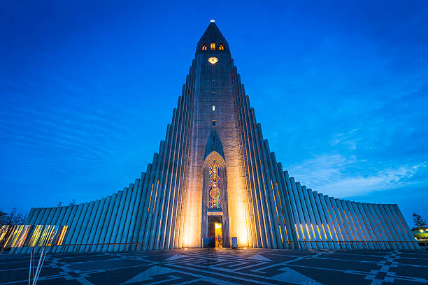 Reykjavik Cathedral Hallgrimskirkja iconic church soaring into dusk sky Iceland The futuristic spire and concrete columns of Hallgrimskirkja, the iconic Lutheran church in the heart of downtown Reykjavik, Iceland's vibrant capital city. ProPhoto RGB profile for maximum color fidelity and gamut. Hallgrímskirkja church stock pictures, royalty-free photos & images