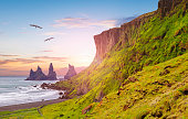 istock Reynisdrangar cliffs at Reynisfjall mountain 1289697299