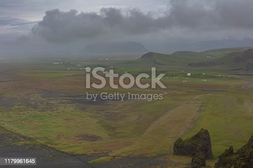 Reynisfjara Black Sand Beach, found on the south coast of Iceland near the village of village of Vik i Myrdal, seen from a cliff during a cloudy morning.