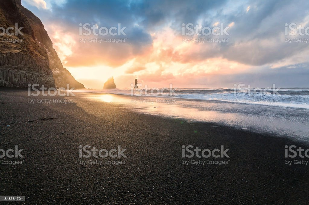 Reynisfjara or better known as Black Sand beach view during sunrise stock photo