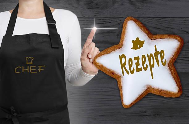 rezepte (in german recipes) cinnamon star is shown by chef - weihnachtsplätzchen rezepte stock-fotos und bilder