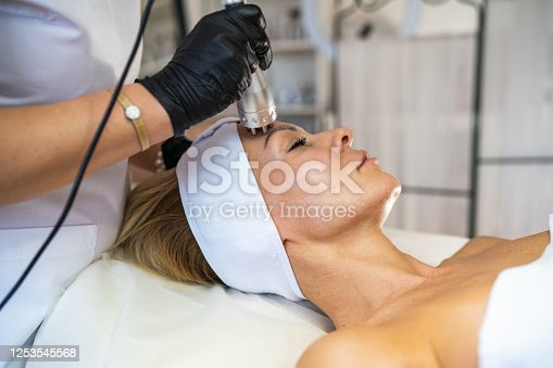 Woman getting rf-lifting on face