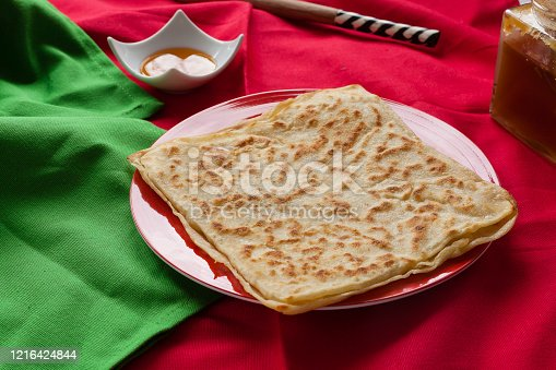 1215965415 istock photo Rghayf or msemen moroccan squared pancakes 1216424844