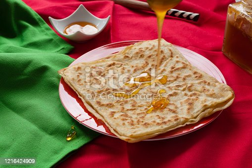 1215965415 istock photo Rghayf or msemen moroccan squared pancakes 1216424909
