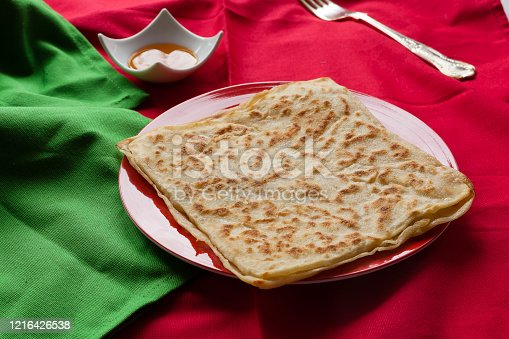 1215965415 istock photo Rghayf or msemen moroccan squared pancakes 1216426538