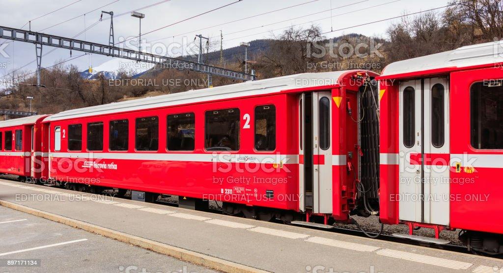 Rhaetian Railway train at the Filisur railway station in Switzerland stock photo