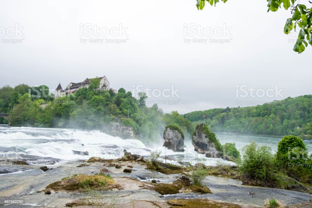 Rheinfall landscape and Schloss Laufen on hill. stock photo