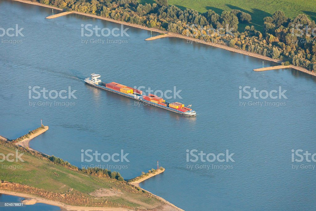 Rhine River with Container Ship in the Lower Rhine Region stock photo