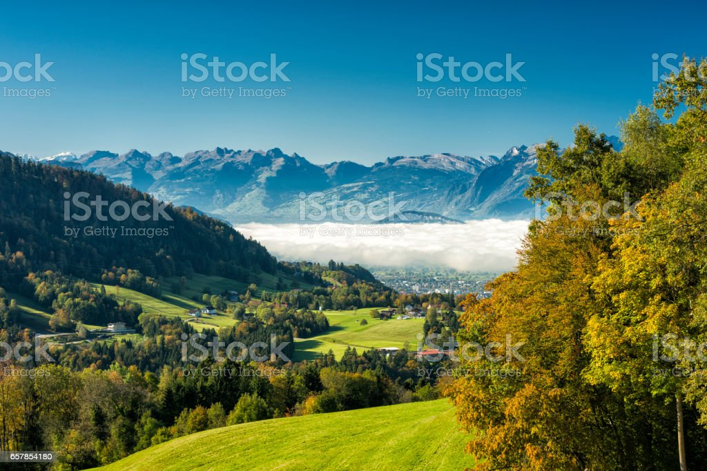 Rhine Valley with some fog and swiss mountains stock photo