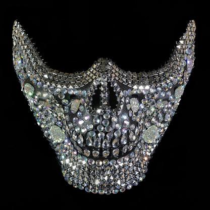 Rhinestone Skull Teeth Mask Isolated Against Black Background