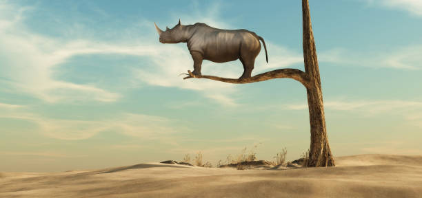 rhino stands on thin branch of withered tree in surreal landscape. This is a 3d render illustration stock photo