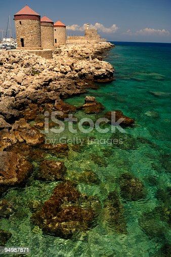 istock Rhodes Mandraki – windmills and lighthouse 94987871