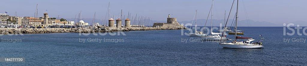 Rhodes Mandraki Windmills / Lighthouse stock photo