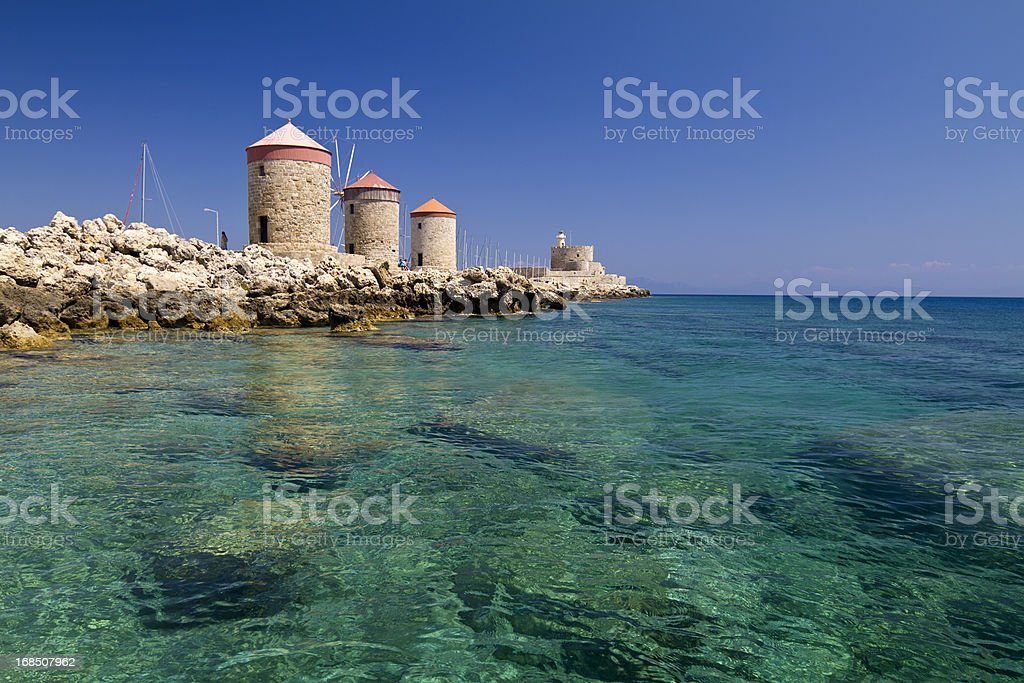 Rhodes Windmills and Lightouse fort stock photo