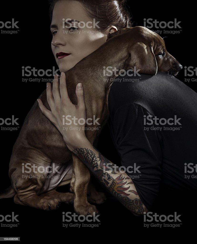 rhodesian ridgeback and her owner stock photo