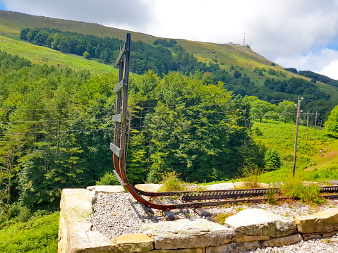 LA RHUNE, FRANCE - march 28, 2019:Rhune Gear Train. Old wooden train and rack railway system in Franci that ascends Mount Larrun, border between Spain and France.