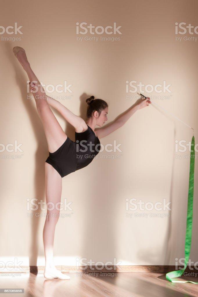 Rhythmic gymnastics. Graceful girl flexibility. Teenage sport,...