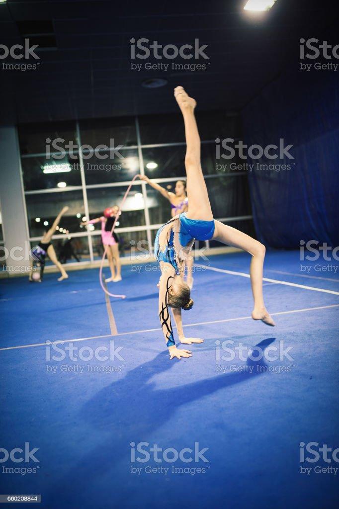 Rhythmic gymnastics group practising together