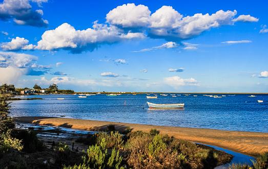 Fisherman boats in Ria Formosa natural park near Olhão in Algarve - Portugal