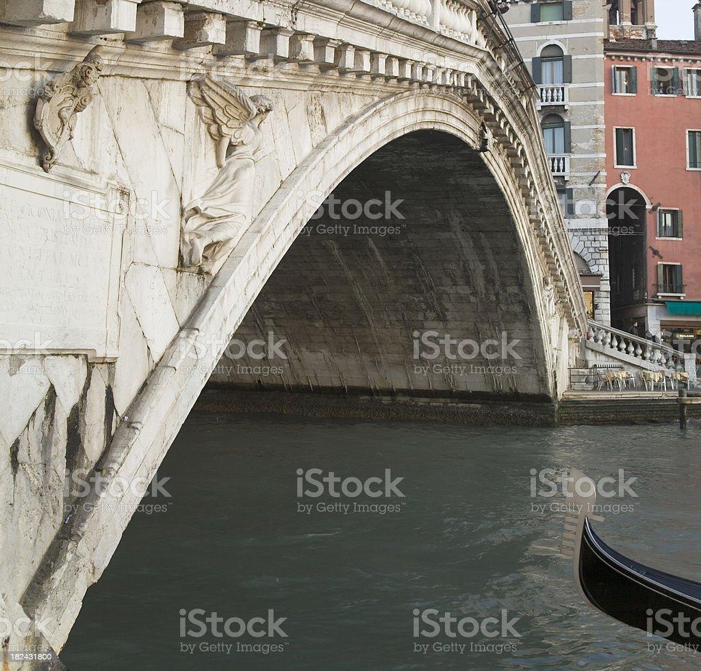 Rialto Bridge and ferro of Gondola in Venice royalty-free stock photo