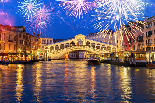 view of famouse Rialto bridge at night with fireworks, Venice, Italy