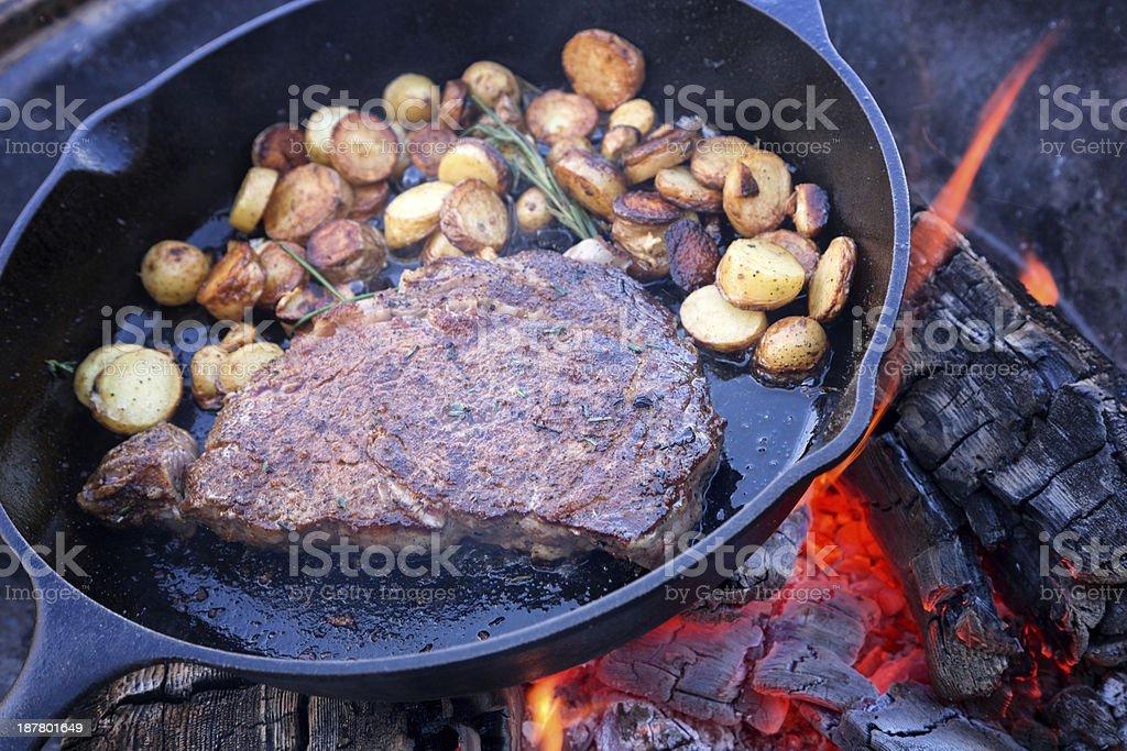 Rib Eye Steak on Campfire stock photo
