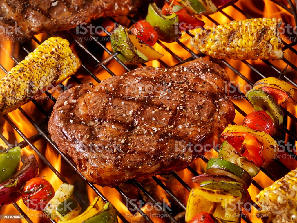 BBQ Rib Eye Steaks with Corn and Veggie Kabobs stock photo