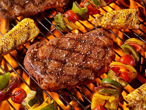 BBQ Rib Eye Steaks with Corn and Veggie Kabobs stock photo