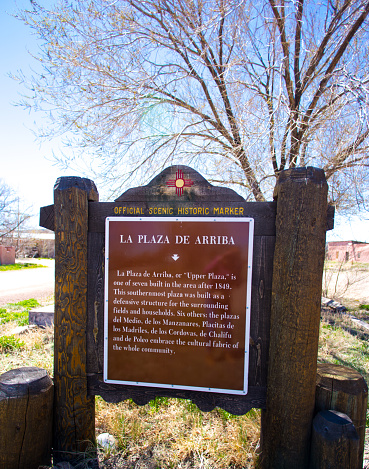 Costilla, NM: A historical marker on the old Plaza de Arriba in Costilla, NM, a traditional adobe village in northern New Mexico in Taos County, near the Colorado border.