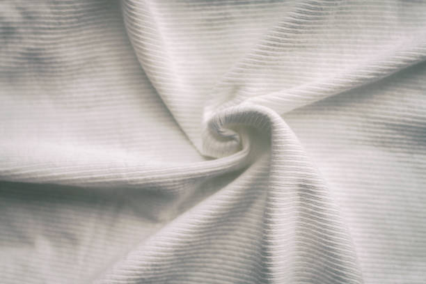 Ribbed fine knit. Colored ribbed knitted cotton fabric warm weather background. stock photo