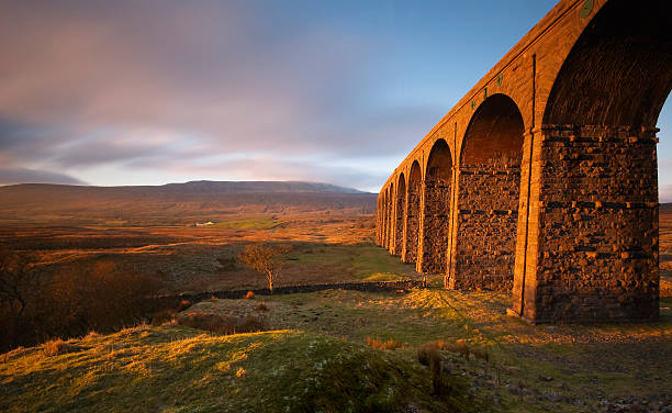 Ribblehead Viaduct II Ribblehead Viaduct on the Settle to Carlisle railway on a late afternoon in December. northwest england stock pictures, royalty-free photos & images