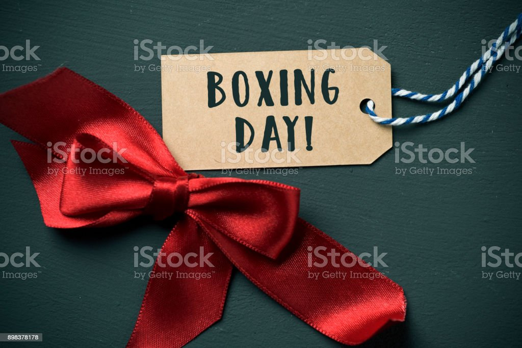 ribbon bow and text boxing day in a swing tag stock photo