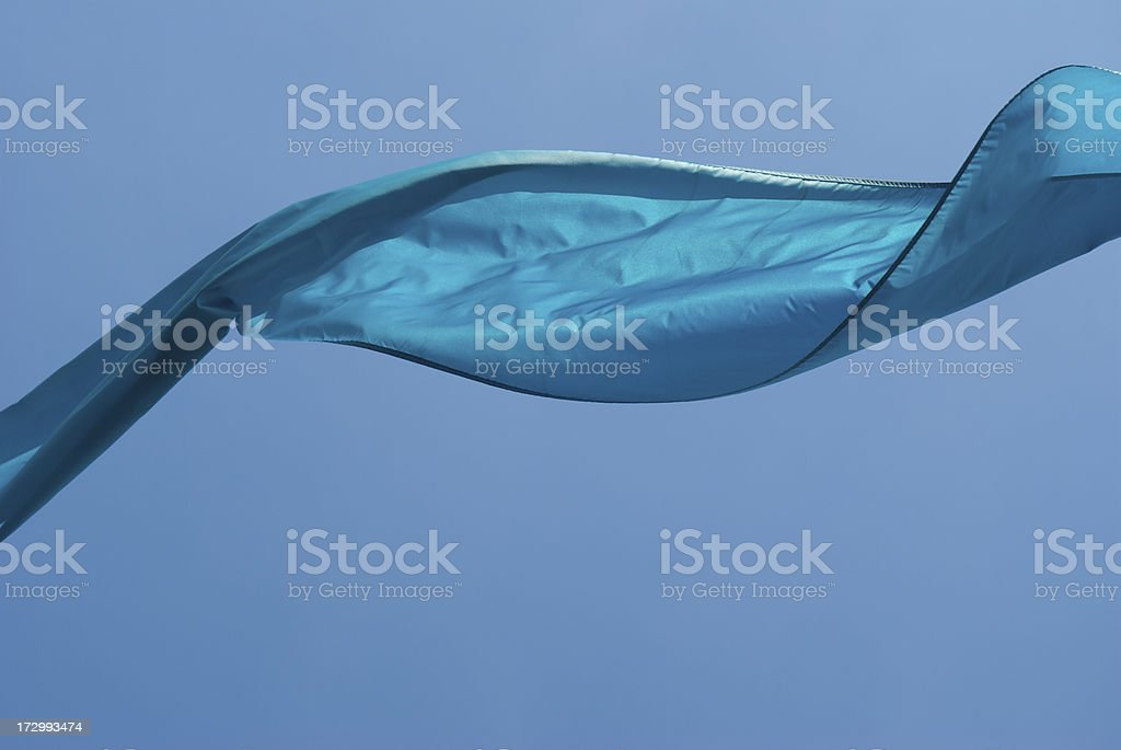 Ribbon of Shiny Blue Fabric in the Sky royalty-free stock photo