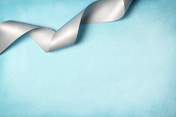 Ribbon on Silk Texture Background stock photo