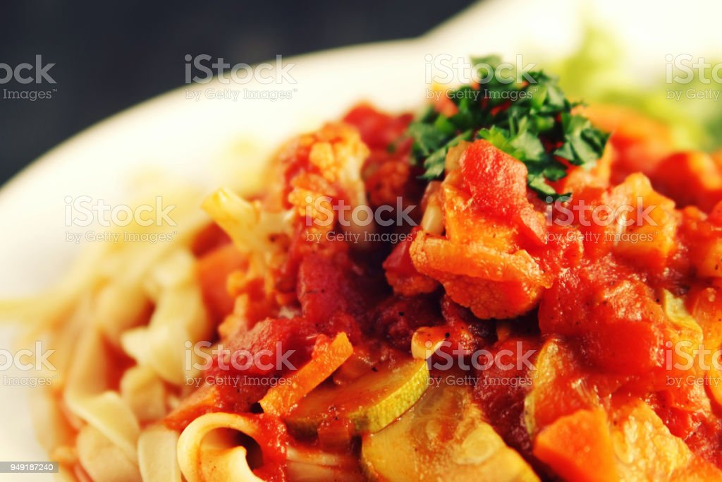 Ribbon pasta with Vegetables and Arrabiata sauce. stock photo