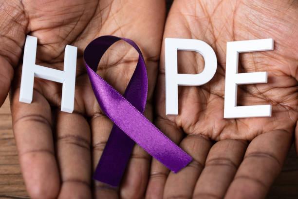 ribbon to support alzheimer's disease awareness - alzheimer imagens e fotografias de stock