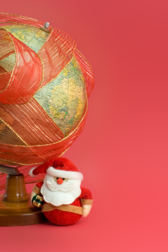 Ribbon Wrapped Globe With Santa Claus Stock Photo - Download Image Now