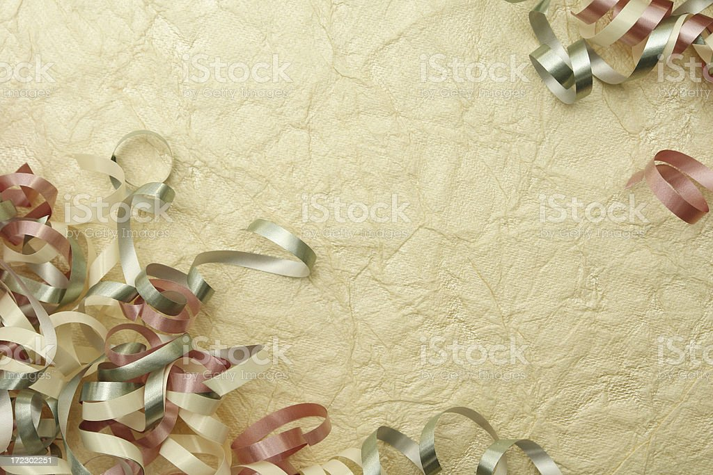 Ribbons on textured paper surface stock photo
