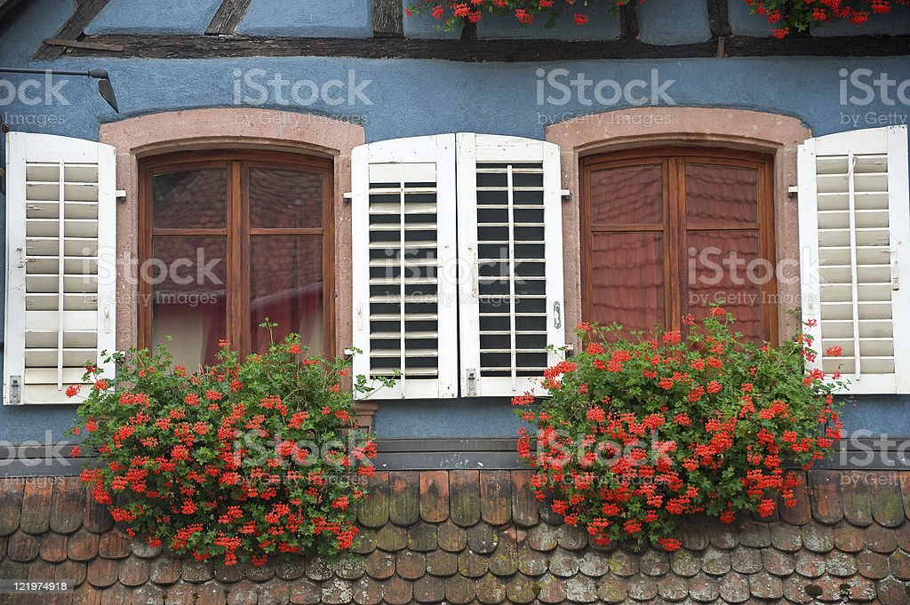 Ribeauville (Alsace, France) - Two windows with red flowers royalty-free stock photo