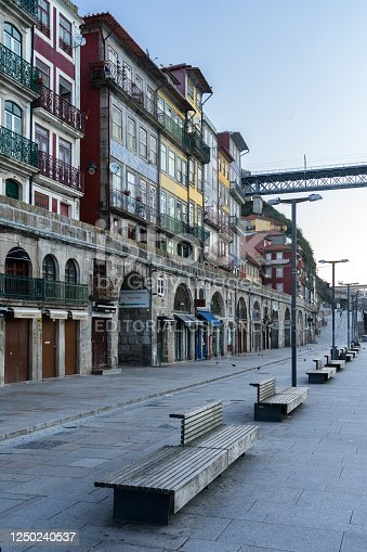 Porto, Portugal - December 02, 2019: A Ribeira zone at sunrise in the old town of Porto with the historical house facades.