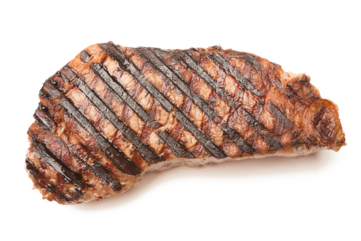 Ribeye Beef Steak with grill marks isolated on white