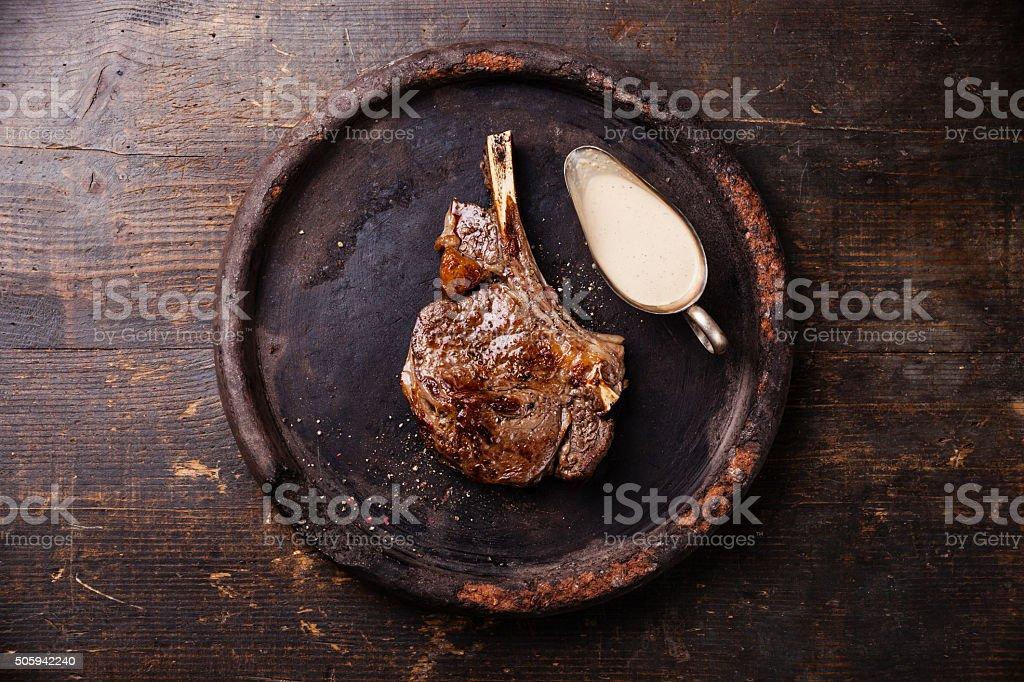 Ribeye Steak on bone with pepper sauce stock photo