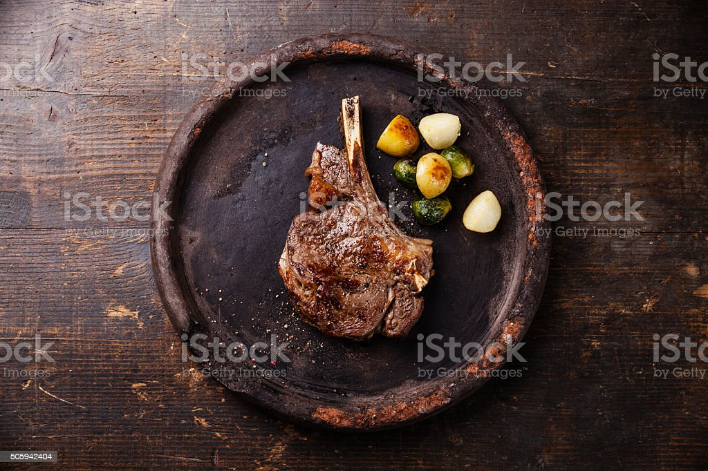 Ribeye Steak on bone with vegetables stock photo