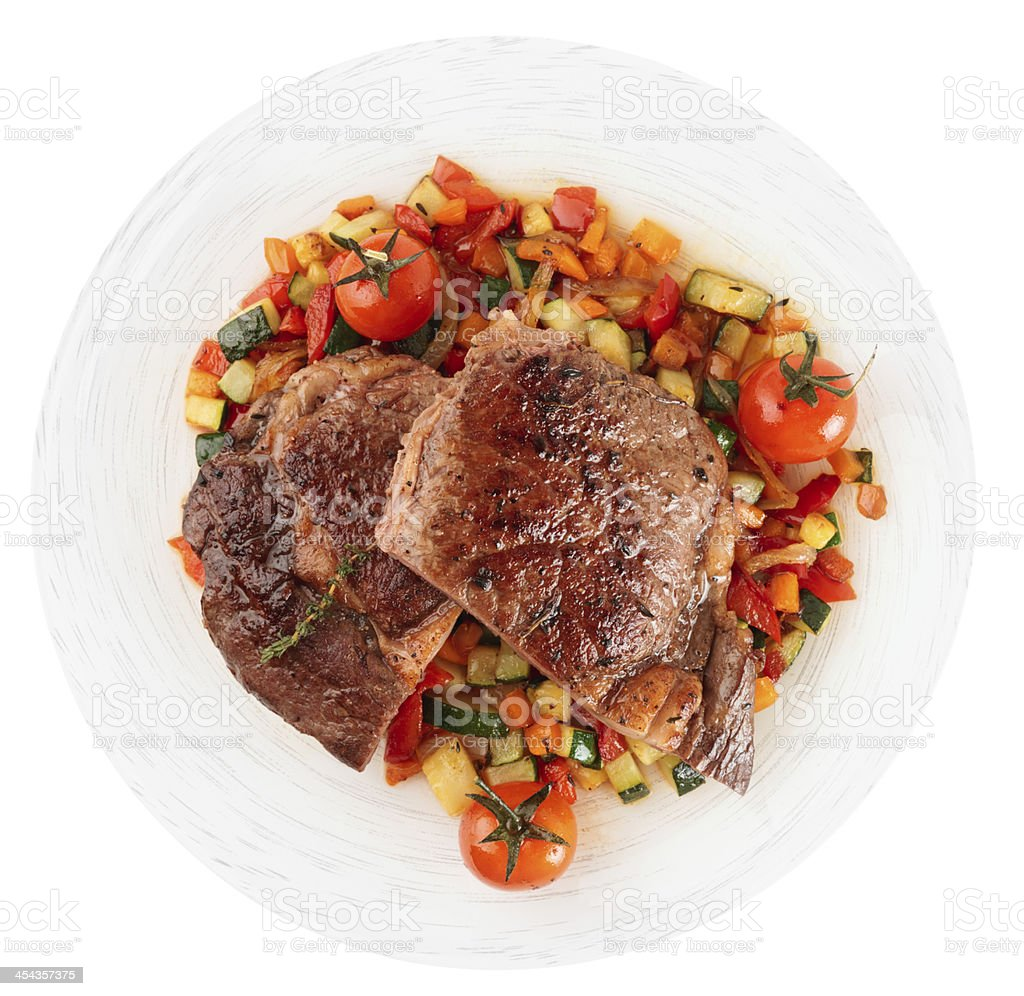 Ribeye steak with fried vegetables isolated on white royalty-free stock photo