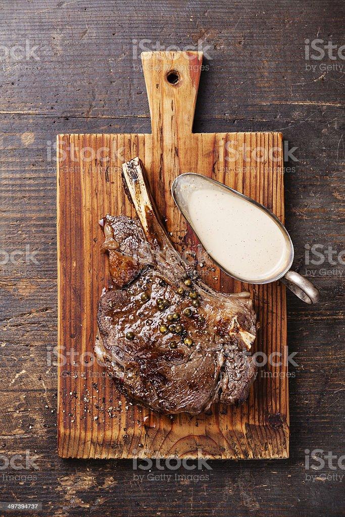 Ribeye Steak with pepper sauce stock photo
