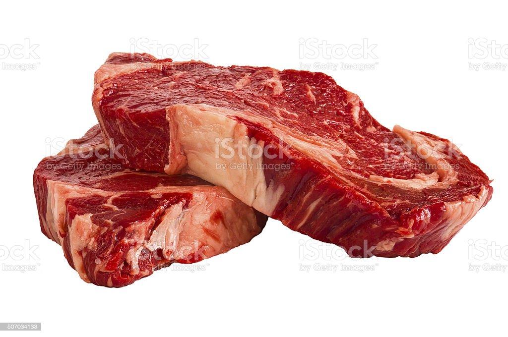 Ribeye steaks isolated on white background stock photo