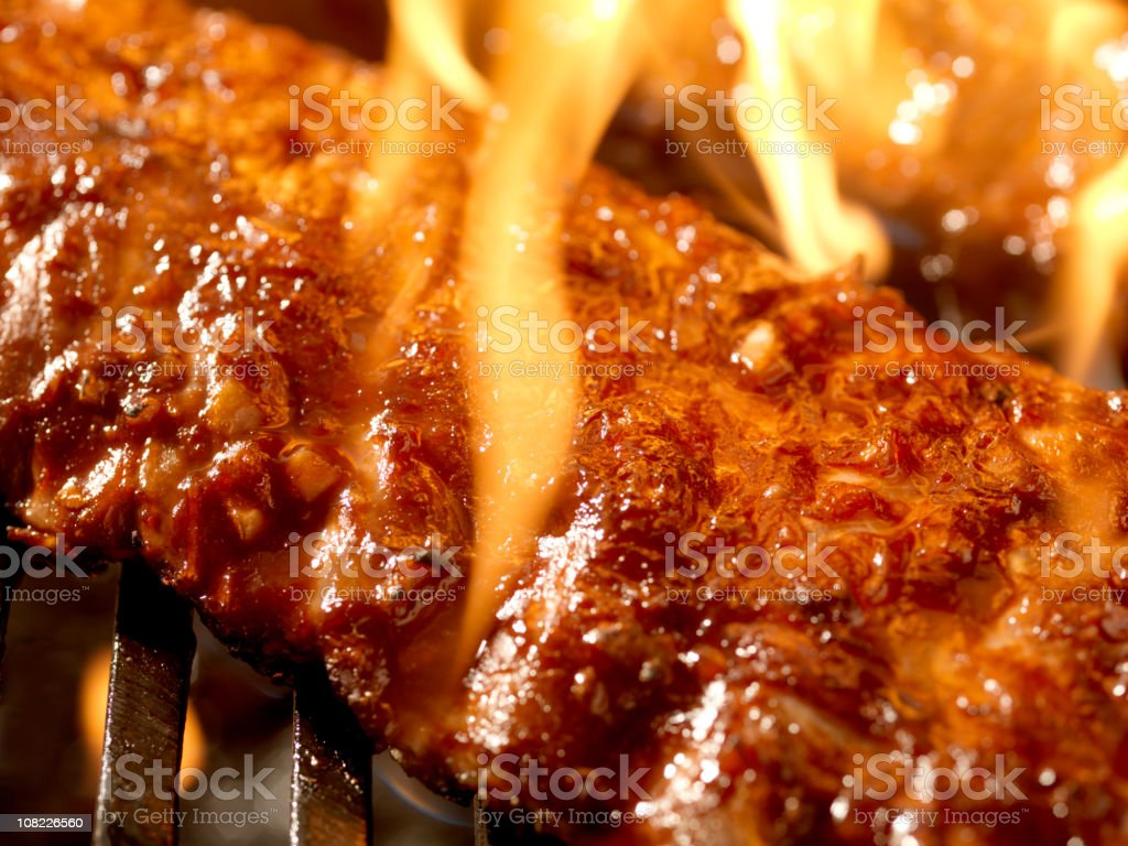 Ribs on BBQ with Open Flame royalty-free stock photo