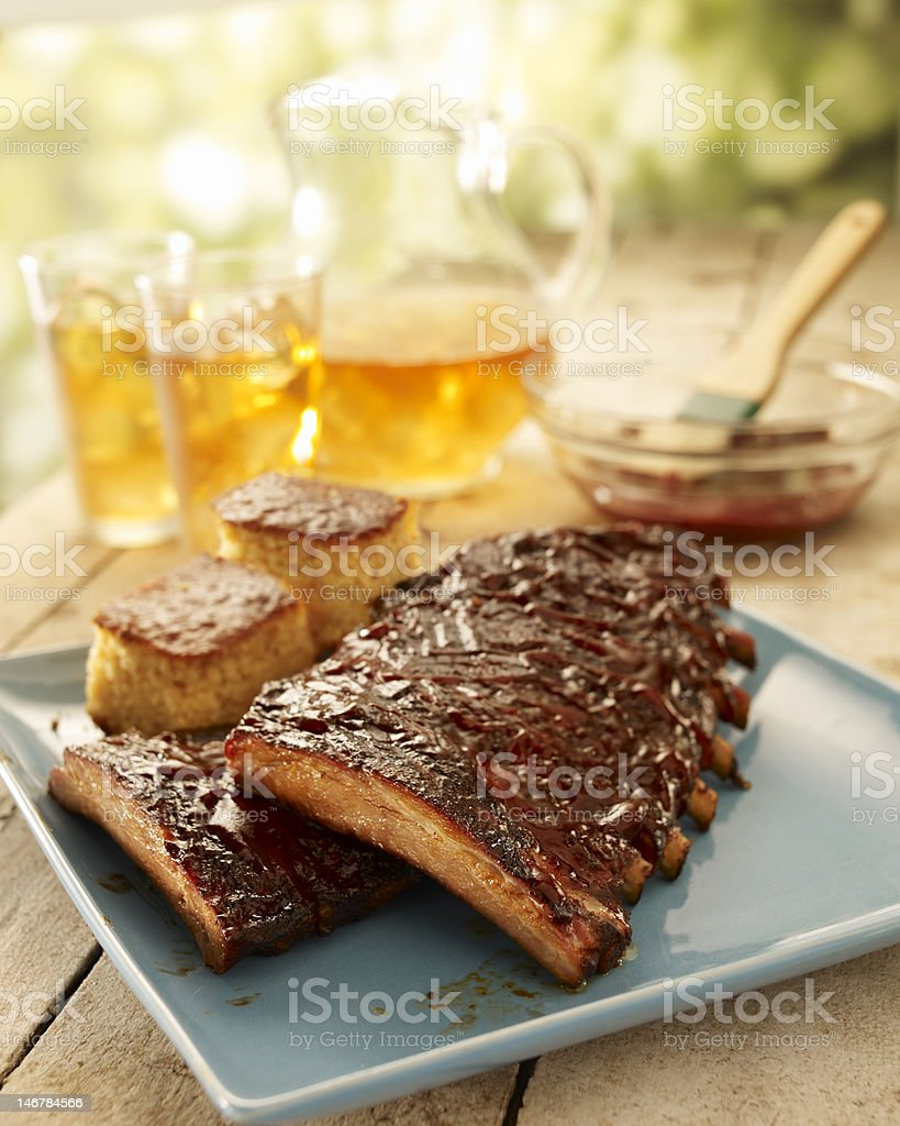 Ribs with barbecue sauce on a platter royalty-free stock photo